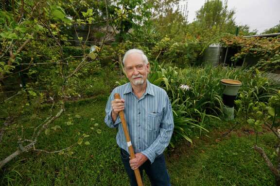 Bob Randall poses in his own plant-packed garden Tuesday, Oct. 29, 2019, in Houston.