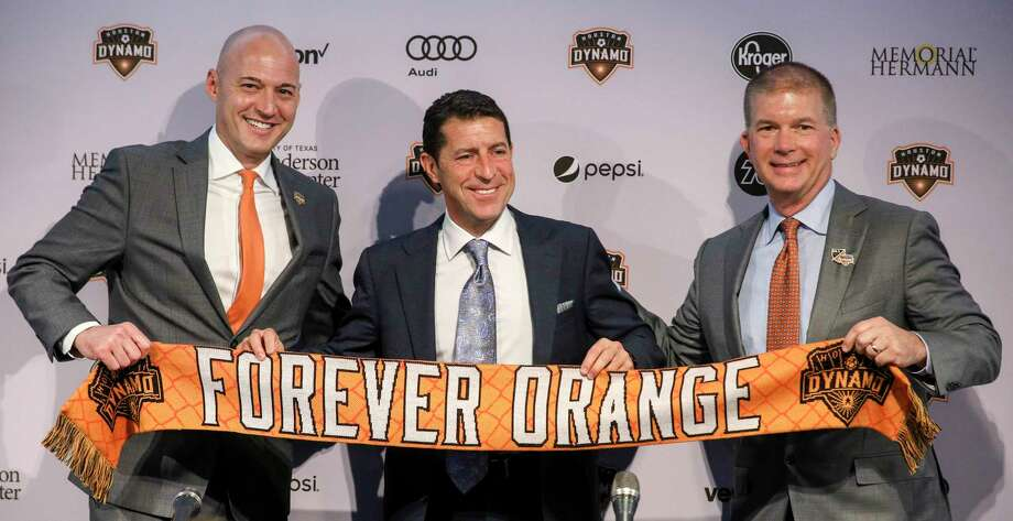 Matt Jordan, from left, senior vice president and general manager of the Houston Dynamo, Tab Ramos, Houston Dynamo head coach, and John Walker, president of business operations, pose for photos during a press conference at BBVA Stadium on Wednesday, Nov. 6, 2019, in Houston. The team formally introduced Ramos, who was previously the U.S. men's U-20 head coach. Photo: Jon Shapley, Staff Photographer / © 2019 Houston Chronicle