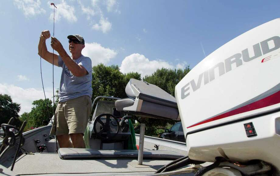 Don Gill, of Huffman, puts up his fishing reel after a morning on Lake Conroe, Friday, July 5, 2019, in Conroe. Photo: Jason Fochtman, Houston Chronicle / Staff Photographer / Houston Chronicle