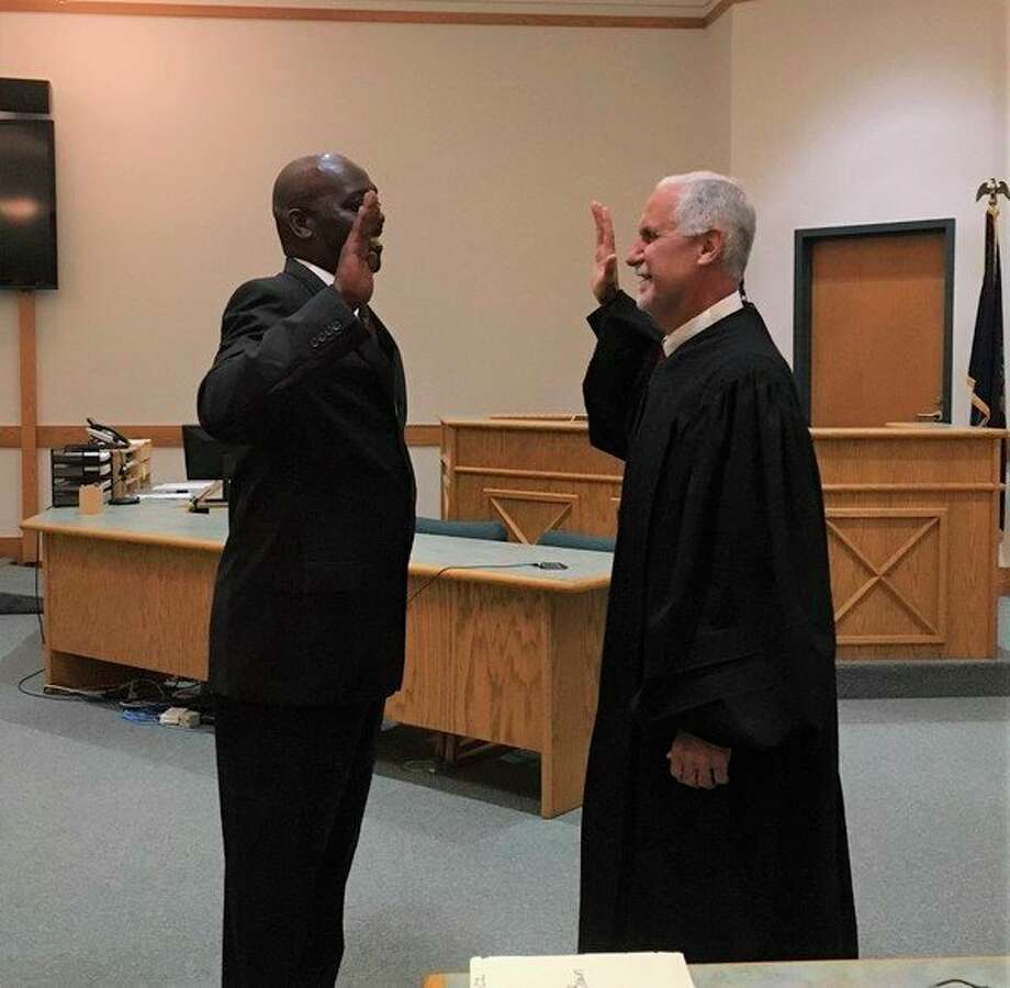 Former Baldwin resident Floyd Brown (left) was admitted into the State Bar of Michigan by Lake County Trial Court Judge Mark Wickens during a ceremony in September. (Courtesy photo)