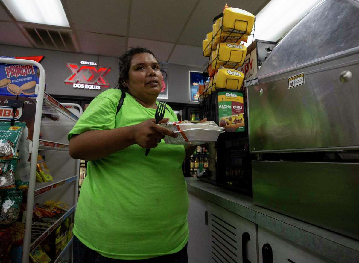 Gabriela Roque uses the microwave at a close by corner store to warm up meals.