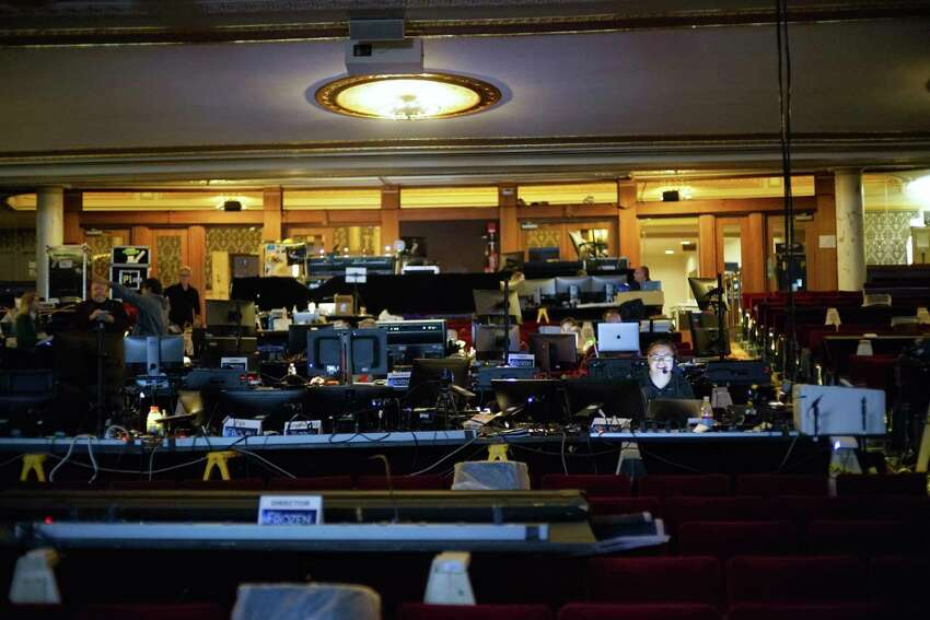 The creative team and production staff teching the musical Frozen work in the seating area inside Proctor's on Tuesday, Oct. 22, 2019, in Schenectady, N.Y. (Paul Buckowski/Times Union)