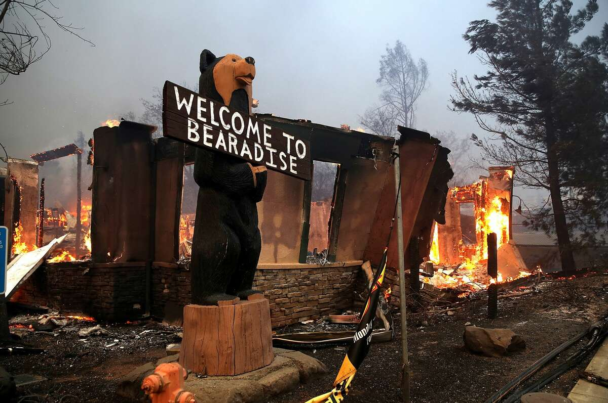 BEFORE: The Black Bear Diner burns as the Camp Fire moves through the area on November 8, 2018 in Paradise, California.