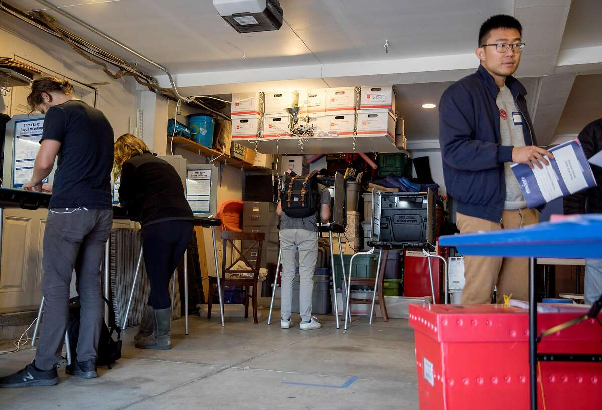 Voters cast their ballots inside a garage polling place along Page Street on Election Day in San Francisco, Calif. Tuesday, Nov. 5, 2019.
