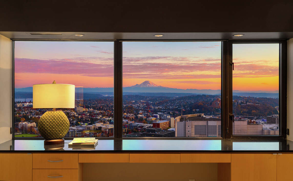 Modern and sleek with a spectacular view, this luxurious First Hill condo asks $1.825M.