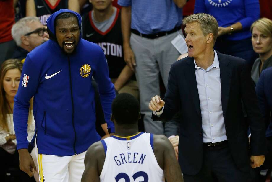 Head coach Steve Kerr, Kevin Durant #35 and Draymond Green #23 of the Golden State Warriors react in the fourth quarter of Game Seven of the Western Conference Finals of the 2018 NBA Playoffs against the Houston Rockets at Toyota Center on May 28, 2018 in Houston. Photo: Bob Levey/Getty Images