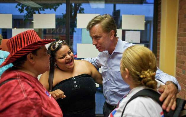 Ned Lamont meets supporters Magdalena Torres, left, Migdalia Castro, center, and Sonia Aguirre before his final pre-primary rally in New Haven. Photo: Andrew Sullivan / Stamford Advocate Freelance