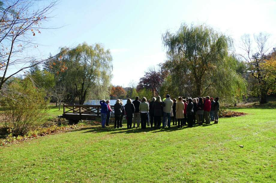 Nearly forty people assembled in New Canaan on Nov. 5, 2019 near where the Mead Memorial Park garage, depot used to stand. One can see the vista behind the building since it was demolished. Photo: Grace Duffield / Hearst Connecticut Media
