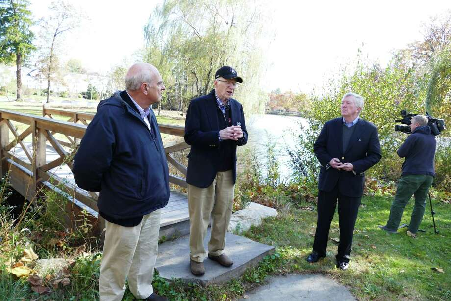 In New Canaan's Mead Memorial Park Jim Bach cut the ribbon for the new Gold Star Bridge as he was flanked by First Selectman Kevin Moynihan and landscape architect Keith Simpson on Nov. 5, 2019. Photo: Grace Duffield / Hearst Connecticut Media