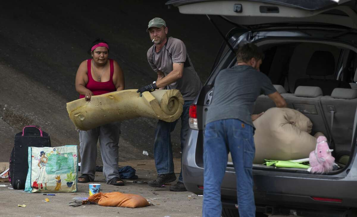 Gabriela Roque loads up her belongings into a van with The Other Ones Foundation, a non-profit helping people move their belongings before TxDOT crews arrived to cleanup homeless encampments Tuesday, Nov. 5, 2019, in Austin, Texas.