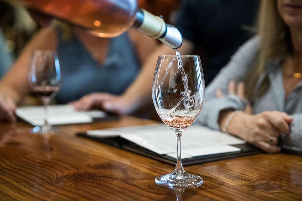 Wine is poured in the tasting room at LangeTwins Winery and Vineyards in Acampo, Calif., on Friday, September 27, 2019.