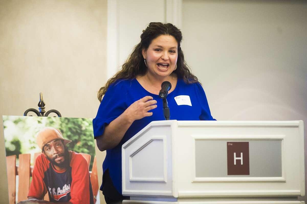 Renee Pettinger, executive director for Midland's Open Door, speaks during the organization's annual Dine on the Doors fundraiser Wednesday, Nov. 6, 2019 at The H Hotel. (Katy Kildee/kkildee@mdn.net)
