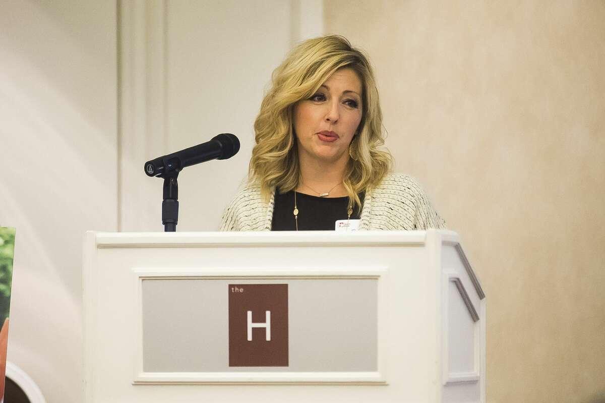 Renee Deckrow speaks during Midland's Open Door's annual Dine on the Doors fundraiser Wednesday, Nov. 6, 2019 at The H Hotel. (Katy Kildee/kkildee@mdn.net)