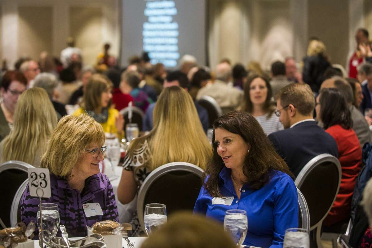 Guests chat during Midland's Open Door's annual DIne on the Doors fundraiser Wednesday, Nov. 6, 2019 at The H Hotel. (Katy Kildee/kkildee@mdn.net)