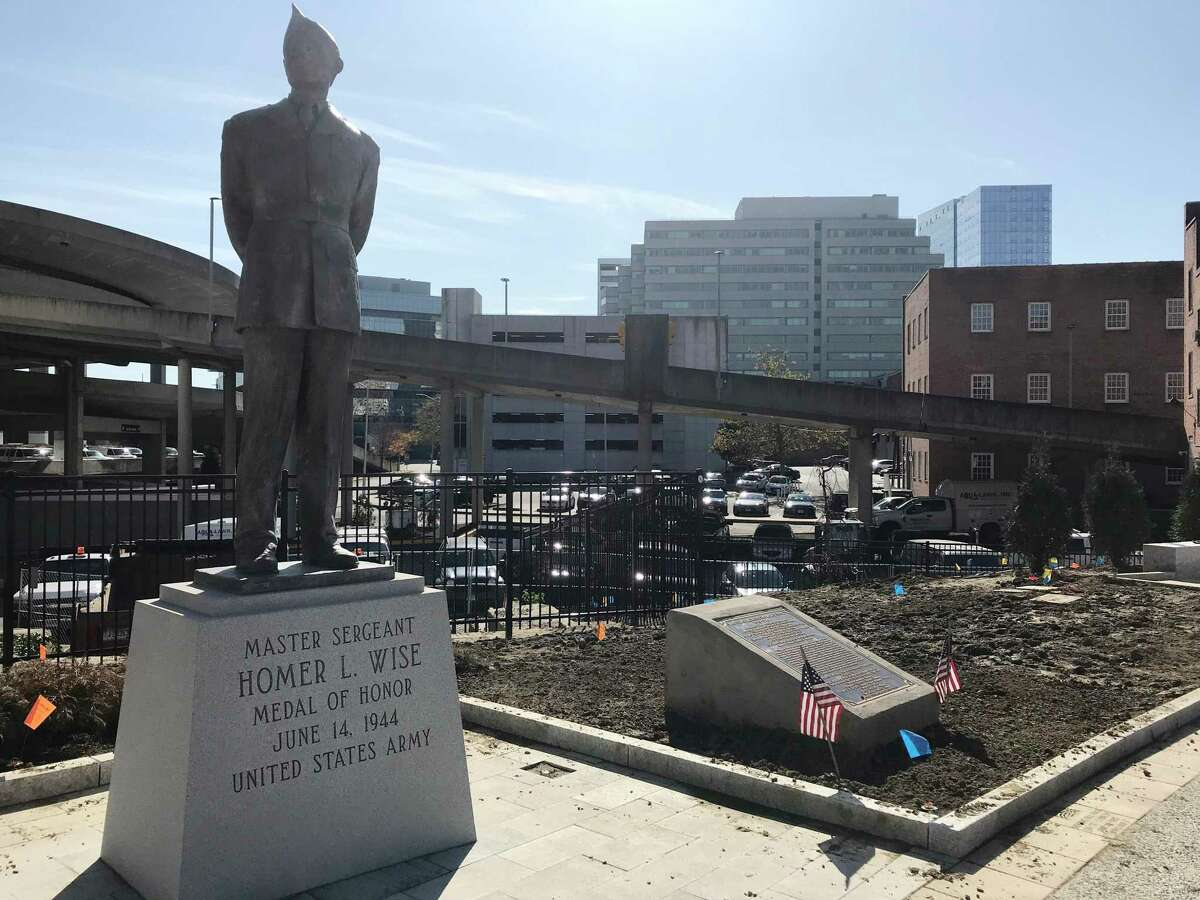 Crews are working to finish the new plaza at downtown's Veterans Park before a re-opening ceremony scheduled for Monday, Nov. 11, Veterans' Day. A parade scheduled for that morning will end at the park at Atlantic and Main streets, which is near the end of a six-year effort to renovate it.