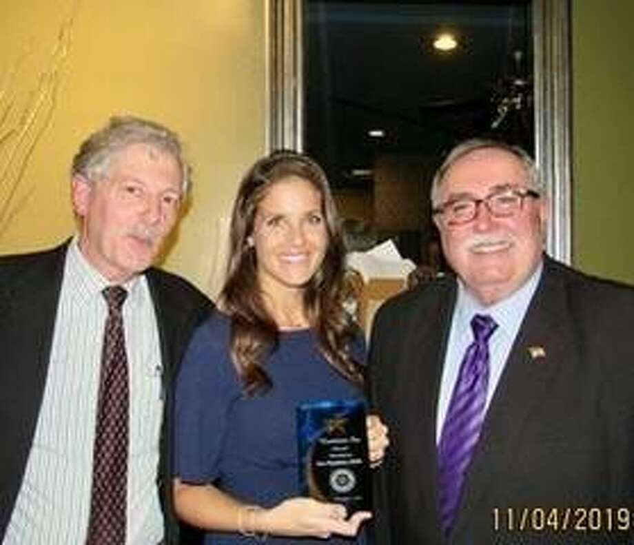 Dr. Sara Hanahan, center, received the Hometown Star Award on Nov. 4 from the Alton Godfrey Rotary. With her is club president Tim Hinrichs, left, and club member John Hopkins who initiated the award in 2015.