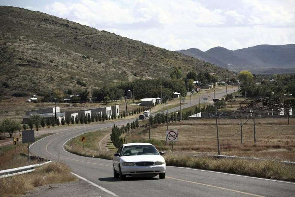 A car passes through Colonia LeBaron, one of many locations where the extended LeBaron family lives in the Galeana municipality of Chihuahua state in northern Mexico, Tuesday, Nov. 5, 2019. Drug cartel gunmen ambushed on Monday three vehicles along a road near the state border of Chihuahua and Sonora, slaughtering at least six children and three women from the extended LeBaron family, all of them U.S. citizens living in northern Mexico, authorities said Tuesday.