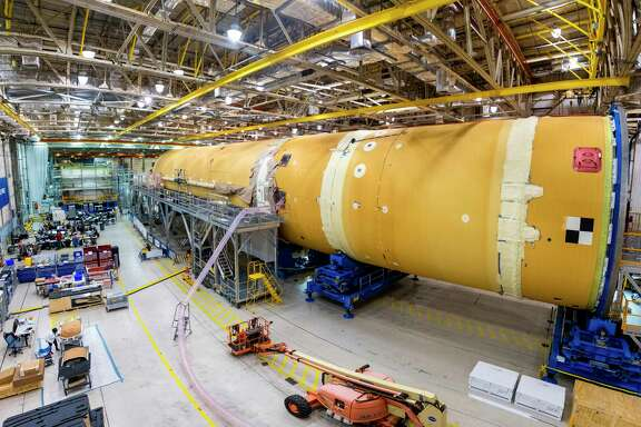This August 2019 photo released by NASA, shows the core stage for NASA's Space Launch System (SLS) rocket at the agency's Michoud Assembly Facility in New Orleans. Kenneth Bowersox, acting associate administrator for human exploration, is casting doubt on the space agency's ability to land astronauts on the moon by 2024. Bowersox told a Congressional subcommittee Wednesday, Sept. 18, 2019, that NASA is doing its best to meet the White House-imposed deadline. But he says he wouldn't bet anything on it. (Eric Bordelon/NASA via AP)