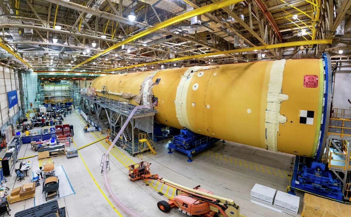 This August 2019 photo released by NASA shows the core stage for NASA's Space Launch System (SLS) rocket at the agency's Michoud Assembly Facility in New Orleans. (Eric Bordelon/NASA via AP)