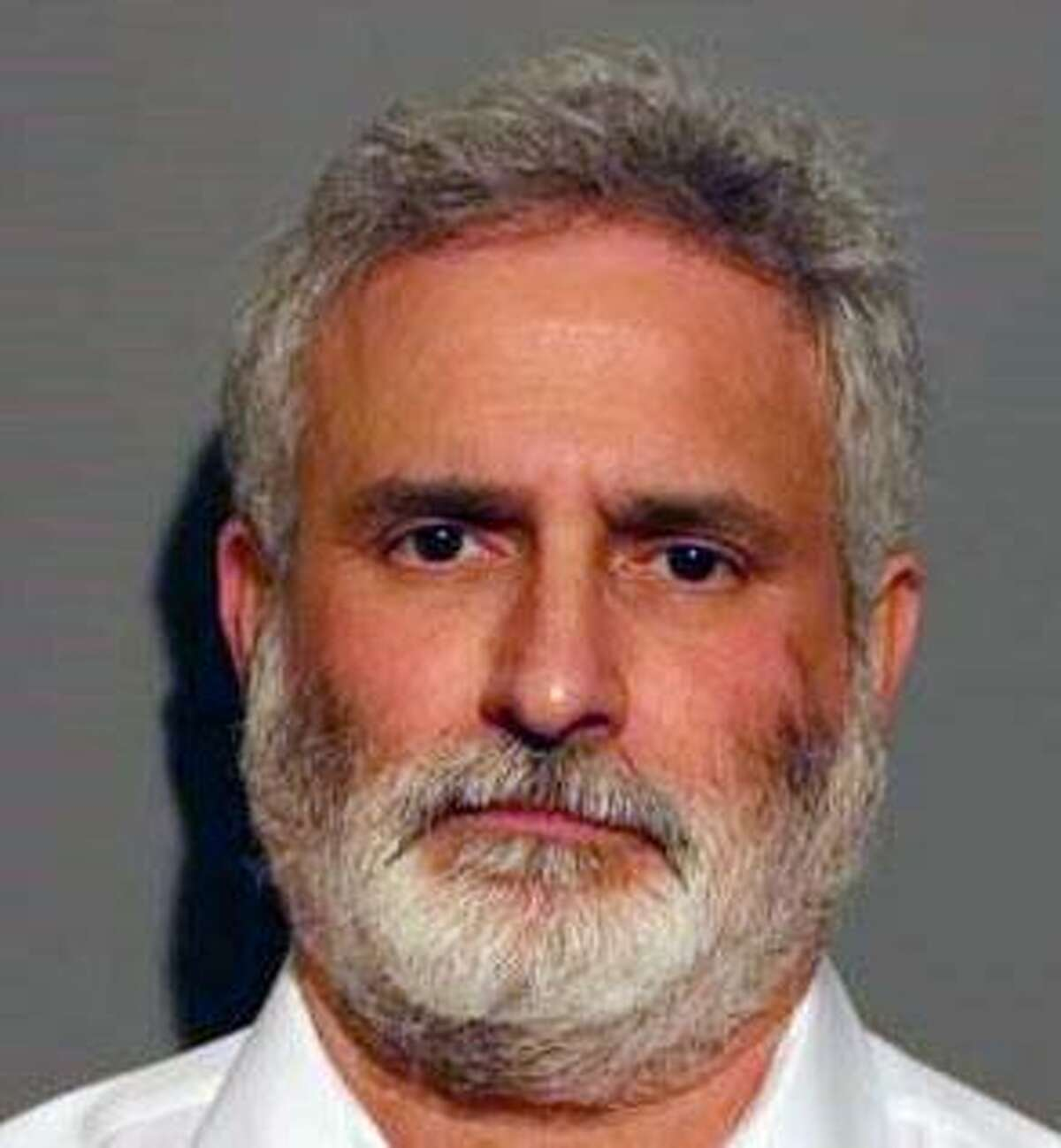 Bruce Gluck, Former Director of Food Services for the New Canaan School District, has been charged with taking nearly one-half million dollars over a five-year period. Photo: Bruce Gluck / New Canaan Police Department / Contributed photo