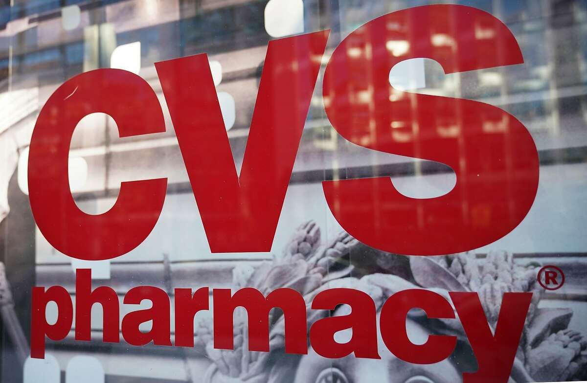 (FILES) In this file photo taken on December 3, 2017 the CVS logo is seen in front of one of its stores in Washington, DC. - US authorities on October 10, 2018 gave the green light to CVS Health's $69 billion takeover of Aetna after requiring the companies to divest a drug prescription program because of antitrust concerns. The Justice Department mandated that the companies divest Aetna's Medicare Part D prescription drug plan for individuals to WellCare Health Plans, saying that allowing CVS and Aetna to combine without imposing this condition would have led to poor service and higher prices in 22 states. (Photo by MANDEL NGAN / AFP)MANDEL NGAN/AFP/Getty Images