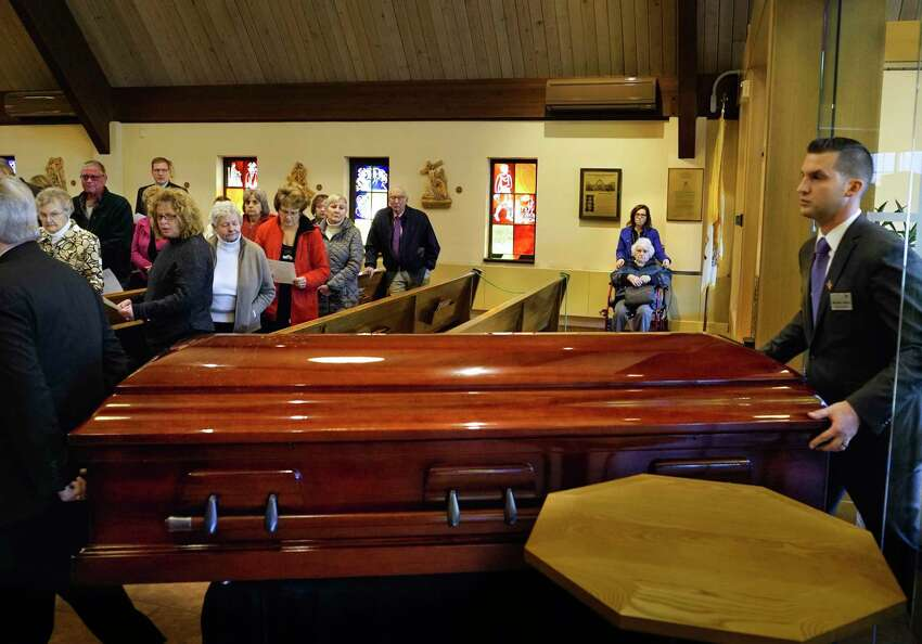 The body of the Rev. John Thomas Connery is brought into the Church of the Immaculate Concept on Wednesday, Nov. 6, 2019, in Glenville, N.Y. (Paul Buckowski/Times Union)