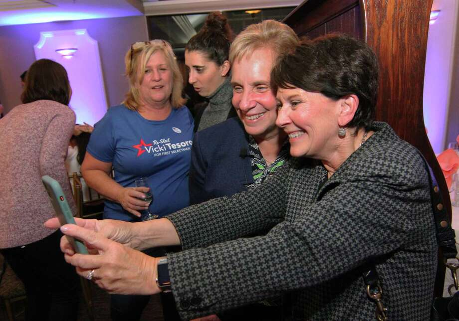 Trumbull First Selectman Vicki Tesoro gets her selfie taken by volunteer Nancy Gardiner during Tesoro's campaign victory party at Tashua Knolls in Trumbull, Conn., on Tuesday Nov. 5, 2019. Photo: Christian Abraham / Hearst Connecticut Media / Connecticut Post