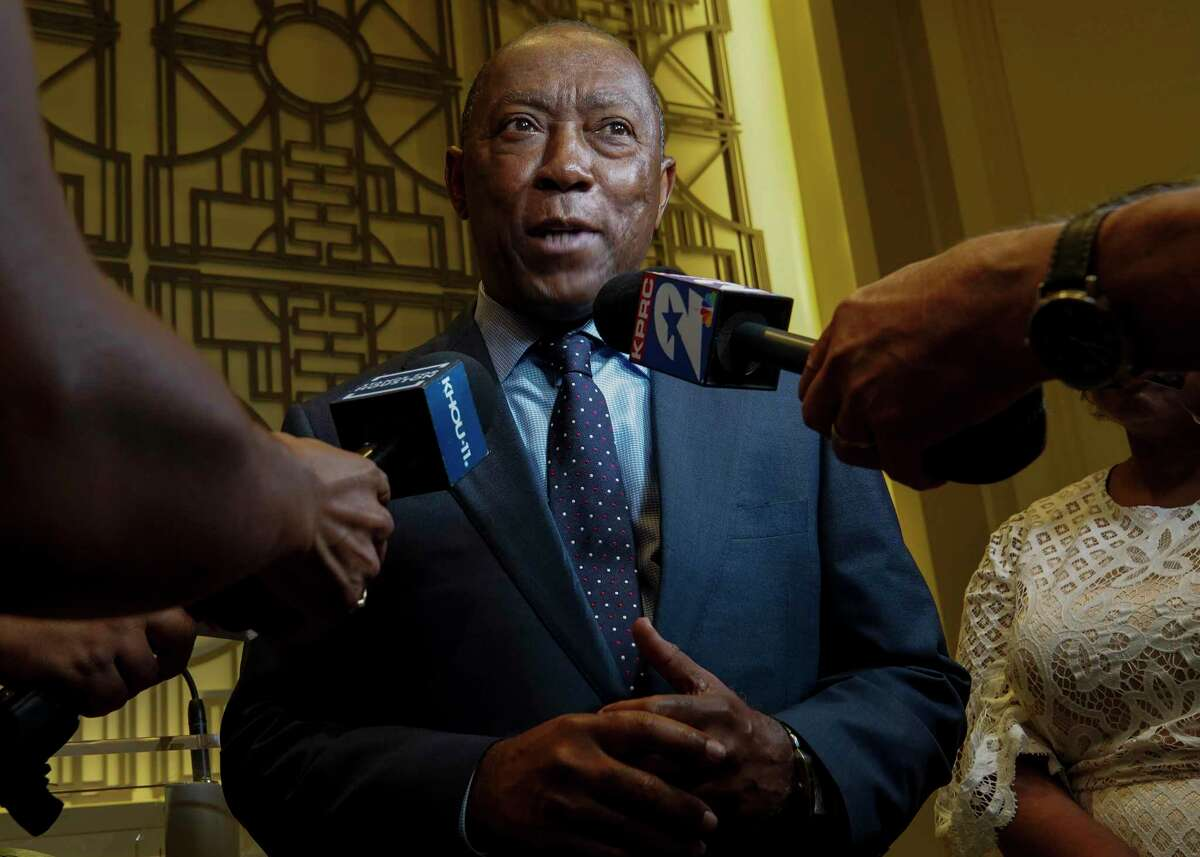 Mayor Sylvester Turner speaks to reporters after a press conference in which he announced a proposed consent decree to improve the city's sanitary sewer system Tuesday, July 9, 2019, in Houston.