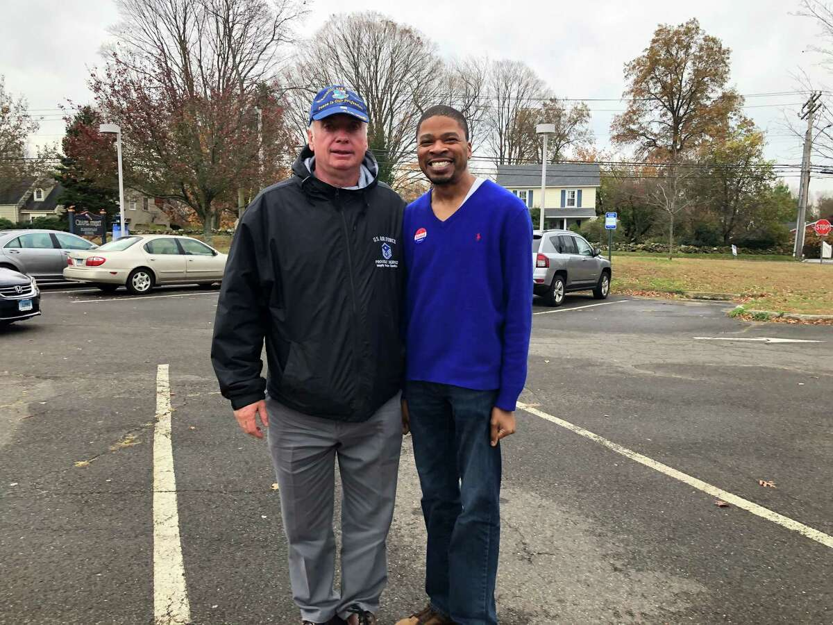 Stratford Democratic Town Council Member David Harden, right, poses for a picture next to Jim Connor, the council's Republican chairman, outside the Chapel Street School on Election Day, Nov. 5, 2019.
