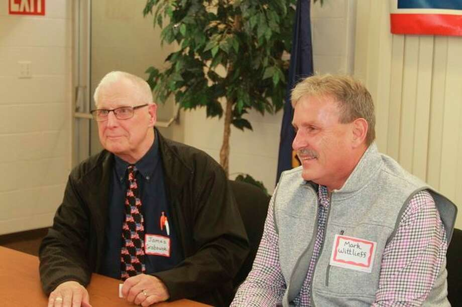 (Left) James Grabowski and (right)Mark Wittlieff spoke about the issues at a League of Women Voters event in October. Following Tuesday's election, Grabowski was reelected to the 6th Districtseat. (News Advocate File Photo)