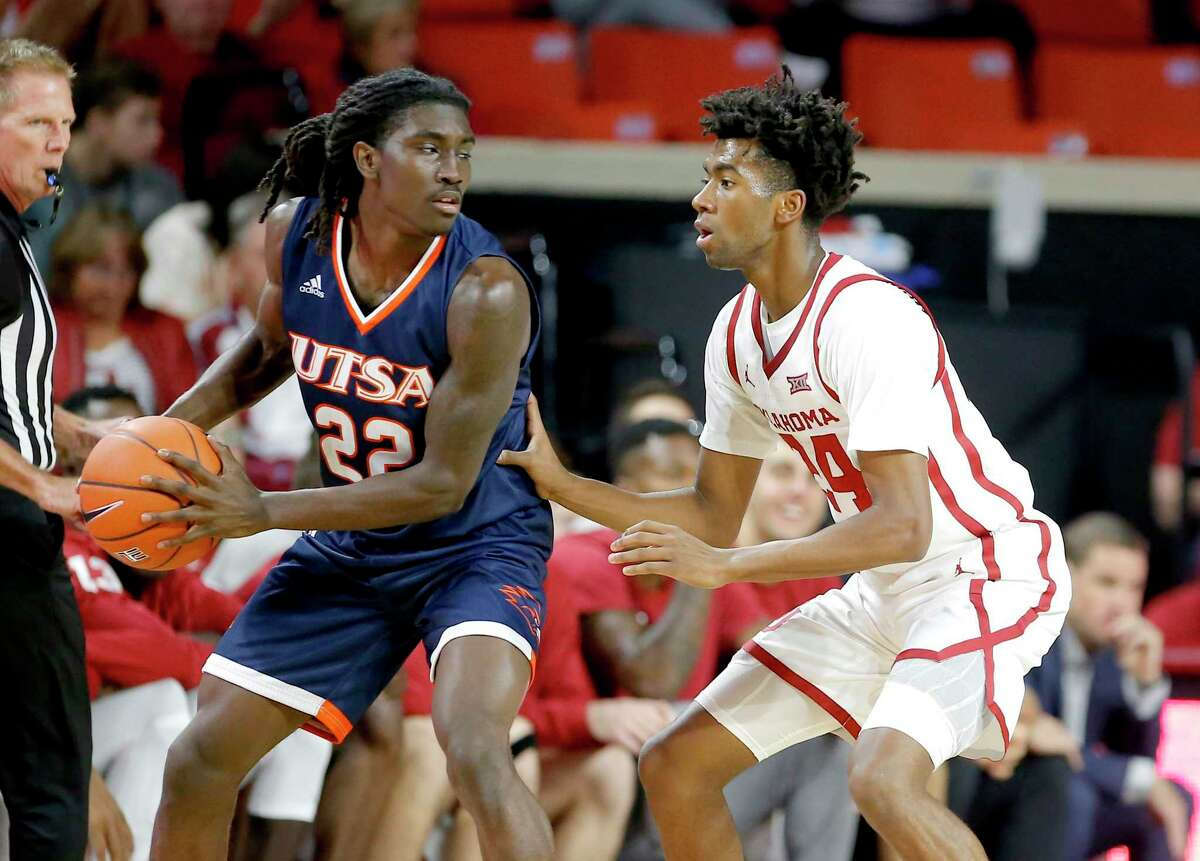 UTSA's Keaton Wallace (22) looks to get around Oklahoma's Jamal Bieniemy (24) during the college basketball game between the University of Oklahoma and the UTSA Roadrunners at the Lloyd Noble Center in Norman, Okla., Tuesday, Nov. 5, 2019. [Sarah Phipps/The Oklahoman]