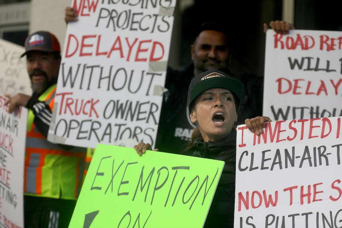 Independent owner Ramona Esquivel (front) off Lavina Trucking protests AB5 in front of 455 Golden Gate Ave. on Wednesday, Nov. 6, 2019, in San Francisco, Calif.