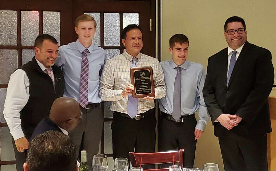 Receiving the Tingley Award from presenter Vic Figueroa (far right) are SHS assistant coach Augie Sevillano, team captain Nick Turco, head coach Isaac Montalvo and team captain Jack Neary. Photo: Contributed Photo / Shelton High Athletics / Shelton Herald