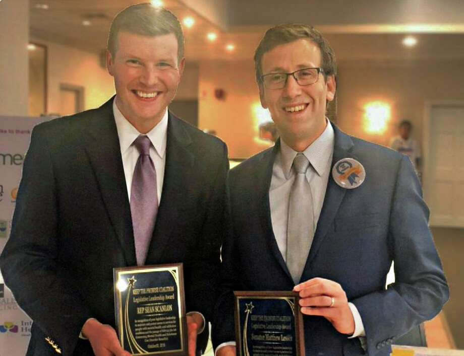 State Sen. Matt Lesser, right, D-Middletown, and state Rep. Sean Scanlon, D-Guilford, left, show off the Legislative Leadership Awards they received from the Keep the Promise Coalition Oct. 30 at the Elks Club in Middletown. Photo: Contributed Photo