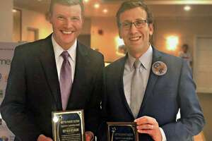State Sen. Matt Lesser, right, D-Middletown, and state Rep. Sean Scanlon, D-Guilford, left, show off the Legislative Leadership Awards they received from the Keep the Promise Coalition Oct. 30 at the Elks Club in Middletown.
