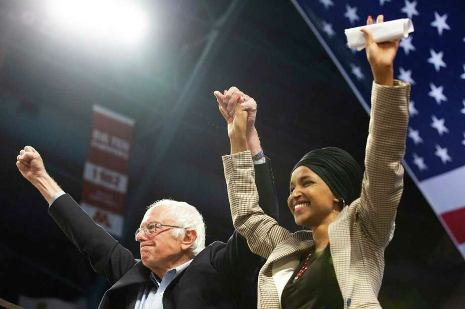 """Sen. Bernie Sanders and Rep. Ilhan Omar take part in a rally Sunday in Minneapolis. Omar mentioned """"Western imperialism"""" during the rally — a reader wants to know what that means. Photo: Evan Frost /Associated Press / Minnesota Public Radio"""