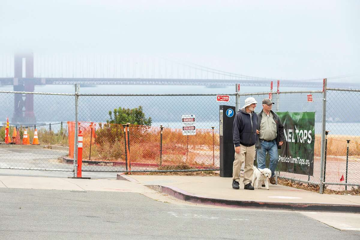 John Fraser (left), his dog Lula, and Rick Black look at the Presidio Tunnel Tops development for which planning started in 2014. The project has a budget that has escalated over the years to $118 million.