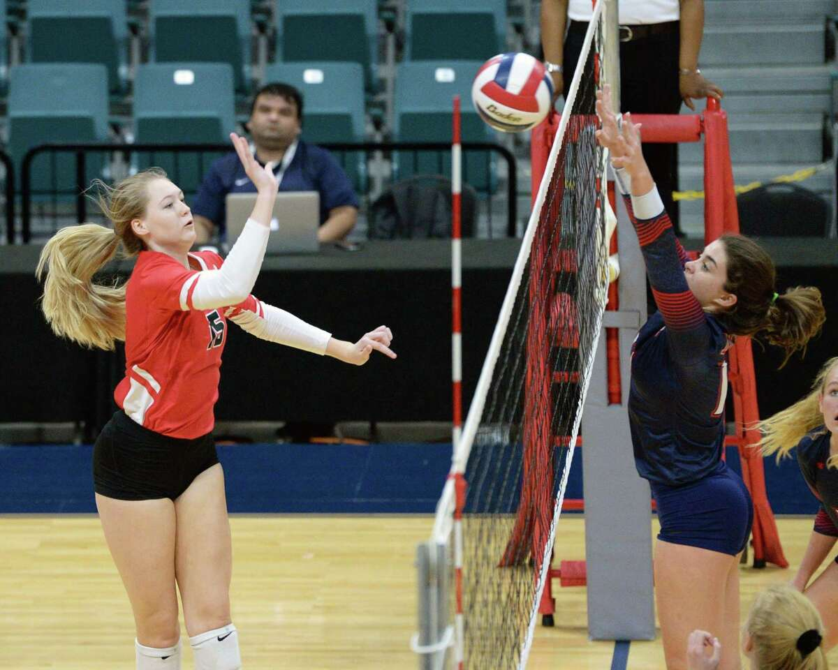 Jordan Gamble (15) of Katy makes a shot during the third set of a Class 6A Region III bi-district volleyball playoff match between the Dulles Vikings and the Katy Tigers on Monday, November 4, 2019 at the Leonard Merrell Center, Katy, TX.