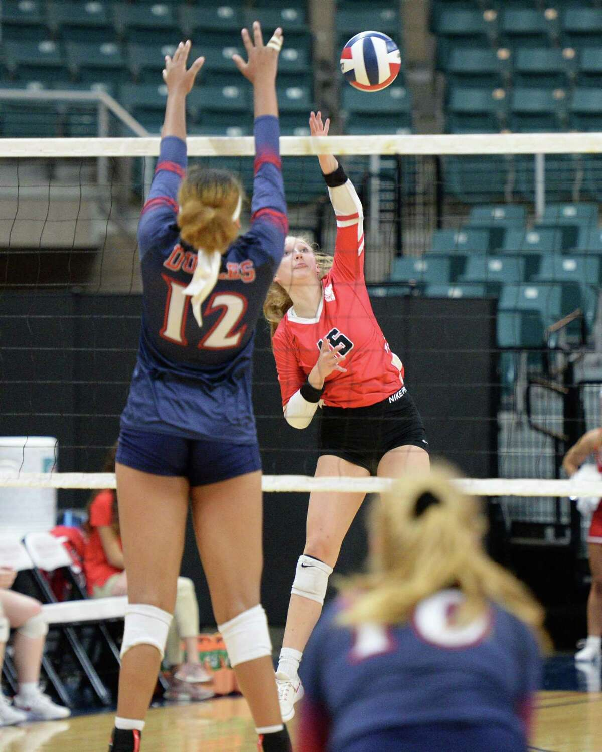 Maddie Waak (16) of Katy attempts a kill shot during the third set of a Class 6A Region III bi-district volleyball playoff match between the Dulles Vikings and the Katy Tigers on Monday, November 4, 2019 at the Leonard Merrell Center, Katy, TX.