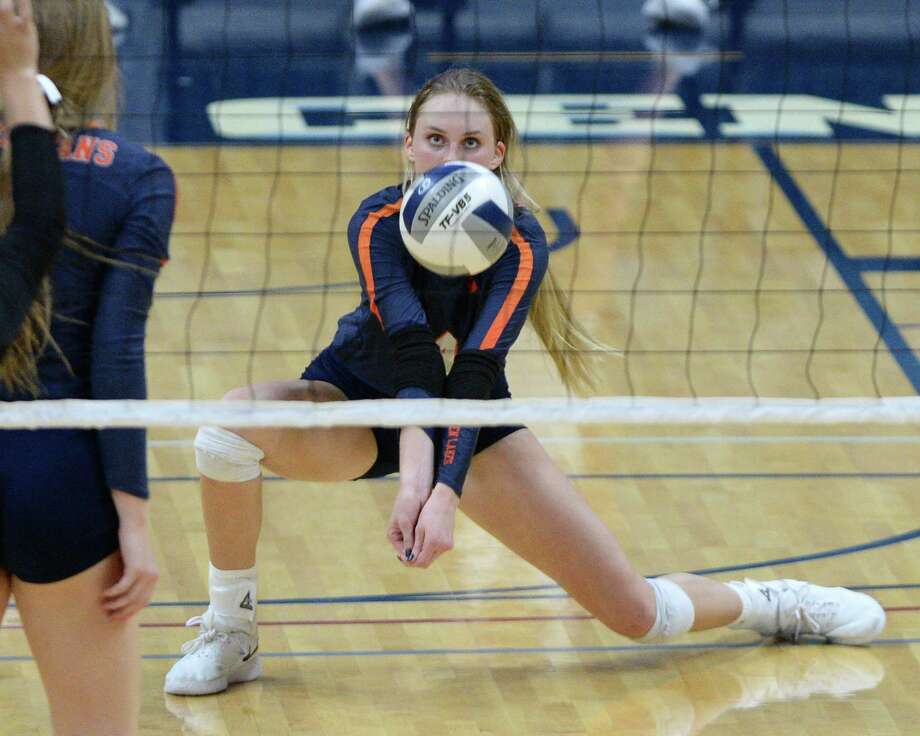 Ally Batenhorst (14) of Seven Lakes digs for a ball during the third set of a Class 6A Region III bi-district volleyball playoff match between the Seven Lakes Spartans and the Ft. Bend Austin Bulldogs on Tuesday, November 5, 2019 at the Leonard Merrell Center, Katy, TX. Photo: Craig Moseley, Staff / Staff Photographer / ©2019 Houston Chronicle