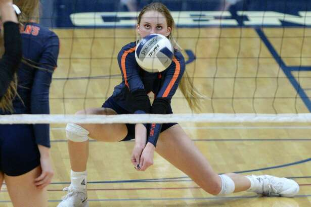 Ally Batenhorst (14) of Seven Lakes digs for a ball during the third set of a Class 6A Region III bi-district volleyball playoff match between the Seven Lakes Spartans and the Ft. Bend Austin Bulldogs on Tuesday, November 5, 2019 at the Leonard Merrell Center, Katy, TX.