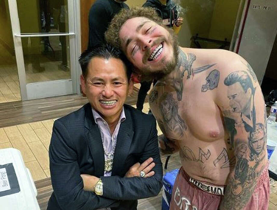 Rapper and singer Post Malone snaps a photo with Houston jeweler Johnny Dang.>>> See some of Dang's custom-made jewelry creations ... Photo: Courtesy