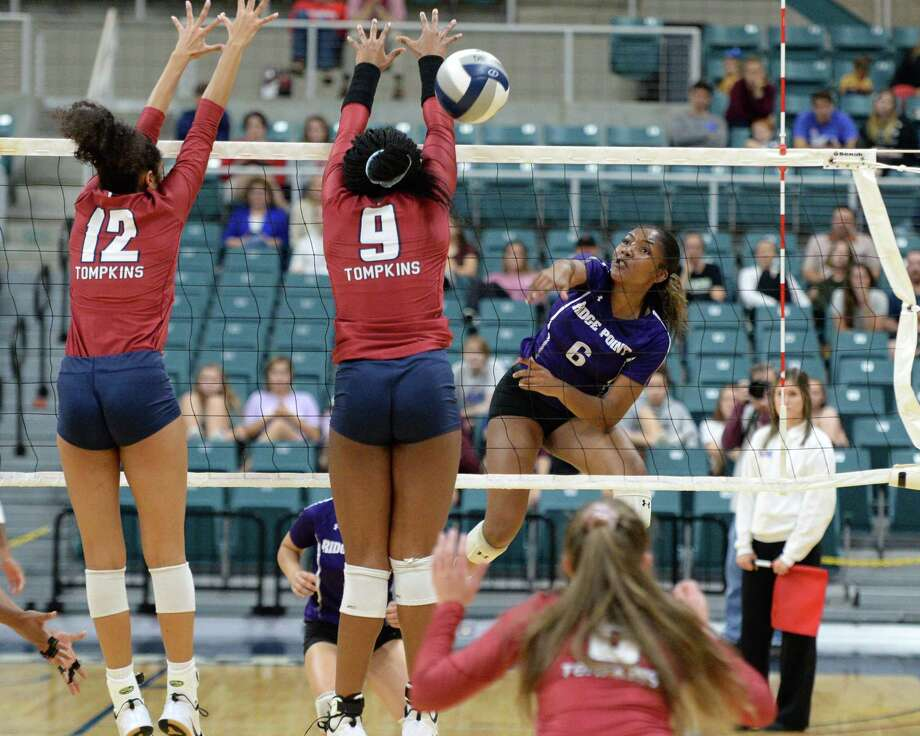 Randee Hennings (6) of Ridge Point hits a shot past Mika Gonzalez (12) and Tendai Titley (9) of Tompkins during the first set of a Class 6A Region III bi-district volleyball playoff match between the Tompkins Falcons and the Ridge Point Panthers on Tuesday, November 5, 2019 at the Leonard Merrell Center, Katy, TX. Photo: Craig Moseley, Staff / Staff Photographer / ©2019 Houston Chronicle