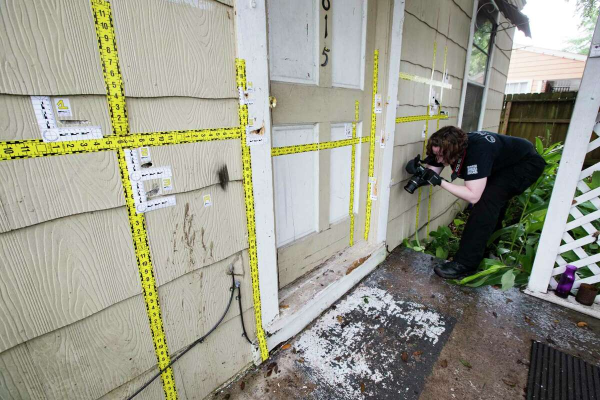 An out of state forensic photographer brought by the family of the killed homeowners at a botched drug raid work the bullet holes still at the home on 7815 Harding on Friday, May 10, 2019, in Houston. The home was the scene of a botched drug raid that took place on Jan. 28, 2019 and left the two homeowners dead and five police officers injured.