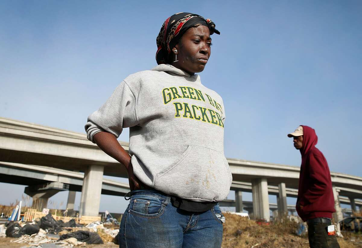 Ieshia Moss contemplates her next move after being forced out of a homeless encampment on Wood Street that she's called home for the past five years in Oakland, Calif. on Tuesday, Nov. 5, 2019. Oakland officials have begun clearing out abandoned cars, motor homes and forcing the residents to leave in an overall effort to completely clear the lot and turn it into a safe parking zone.