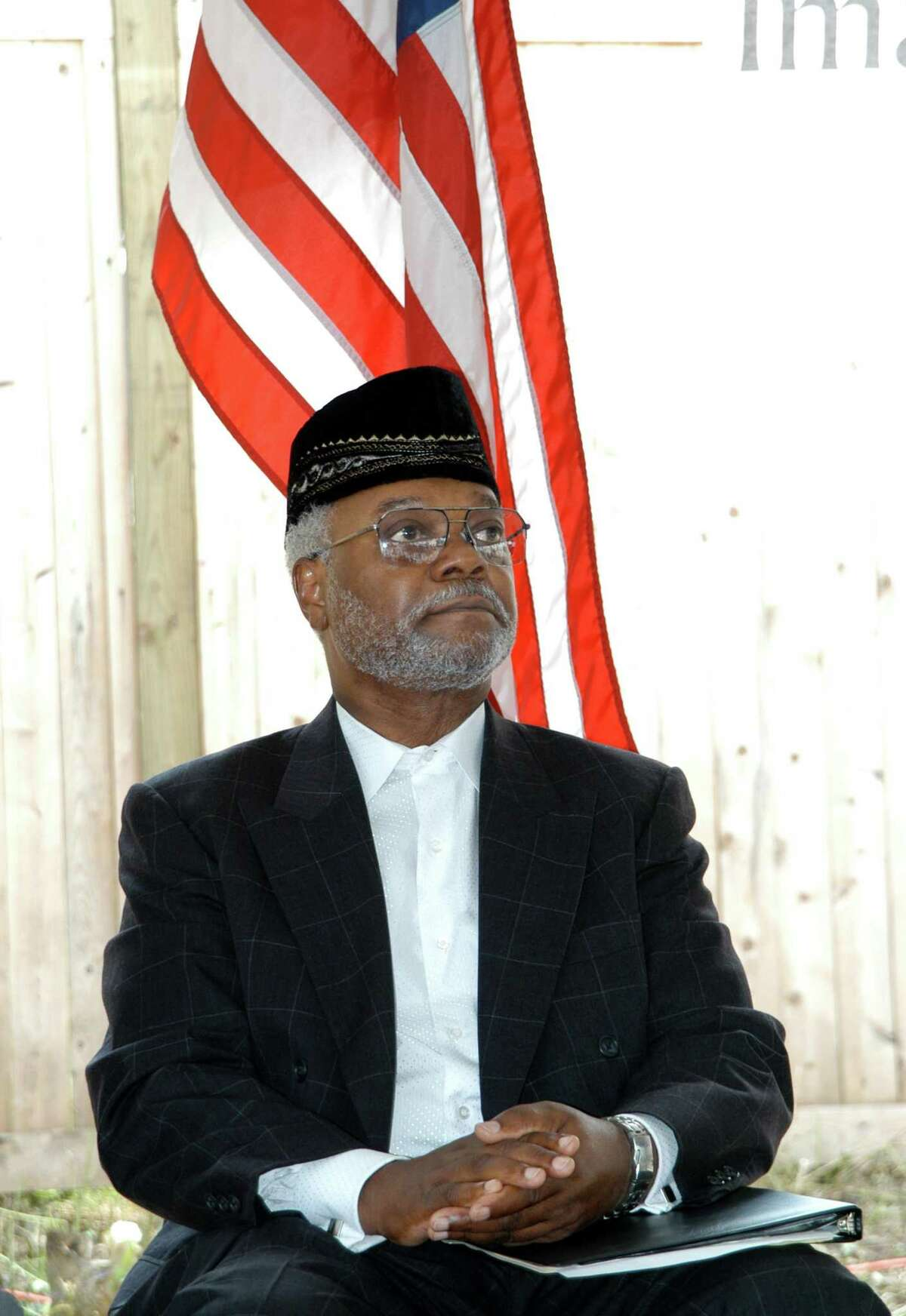 Imam Abdul-Majid Karim Hasan listens to speakers honoring him at a special ceremony at his Hamden mosque in 2004.