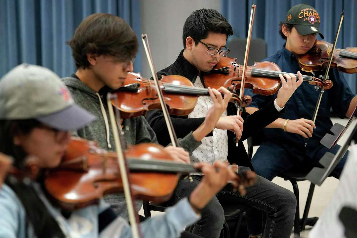 Violinists Abby Elorza, left, Alexys Gonzalez, Ricardo Jimenez, and Zuriel Longoria, right, play during the Mariachi Pumas rehearsal at University of Houston Tuesday, Oct. 22, 2019, in Houston.