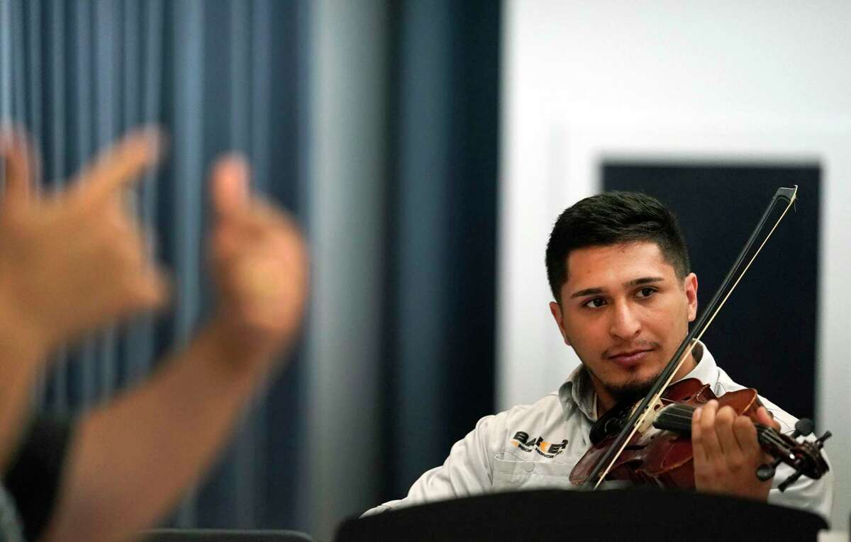 Jose Pineda plays the violin during the Mariachi Pumas rehearsal at University of Houston Tuesday, Oct. 22, 2019, in Houston.