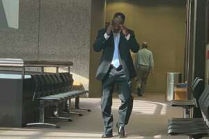 Calvin Walker talks on the cell phone after his probation hearing.