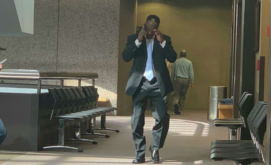 Calvin Walker talks on the cell phone after his probation hearing. Photo: Isaac Windes